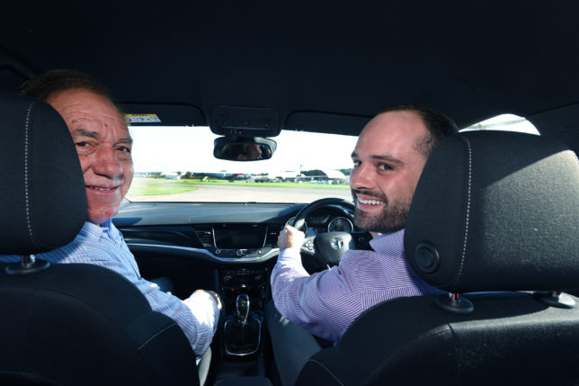 Magazine writer Michael Parr (with beard) learns the skill of fast driving from Rob Wilson in a Vauxhall Astra at Bruntingthorpe Proving Ground.