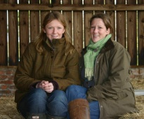 Lucy and Emma in a barn