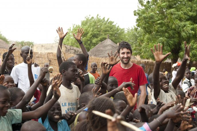 Mark Watson with some of the children supported by Action Aid