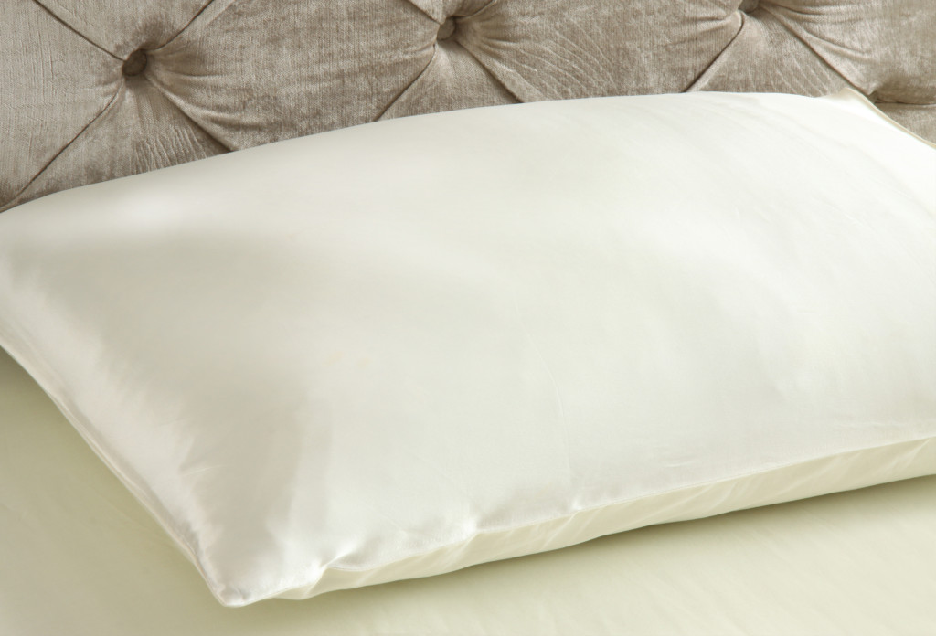 Silk Pillow On Bed