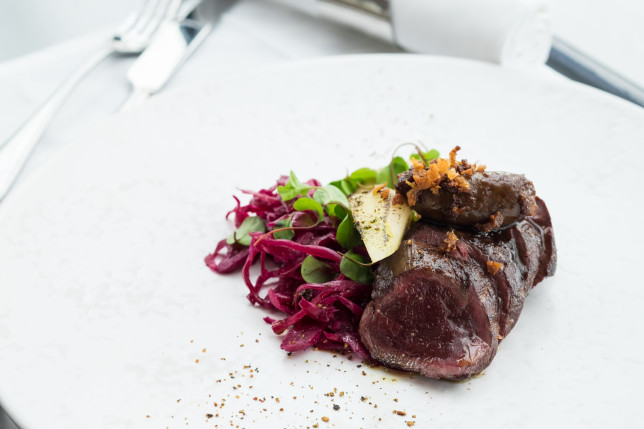 Loin and sausage of venison, pickled red cabbage, pear and juniper