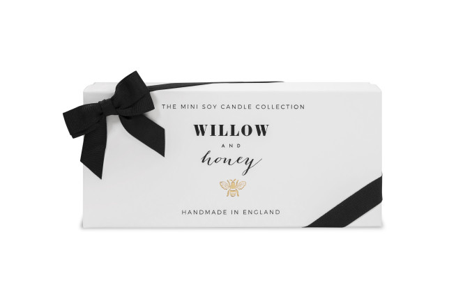 scented candle by willow and honey
