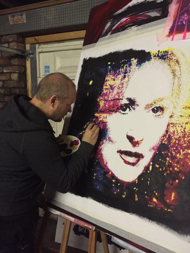 Lincoln applying finishing touches to Meryl Streep portrait