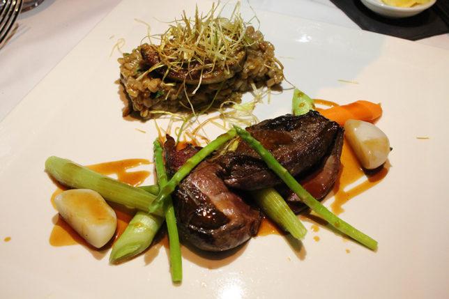 Pan-seared Aylesbury duck breast, Foie Gras nugget Organic mushroom and garlic spelt risotto, baby vegetables, thyme jus