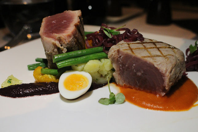 Grilled yellow fin tuna Confit basil potatoes, tomato and anchovy fondue